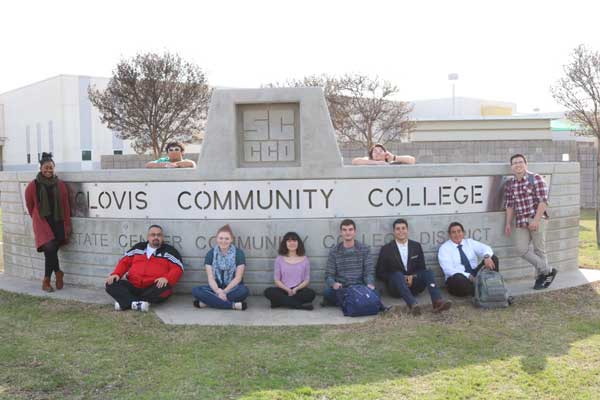 Students standing in front of CCCs outside logo