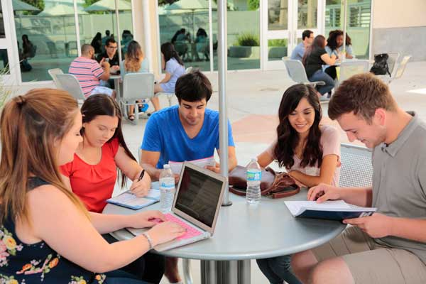 students studying in patio area