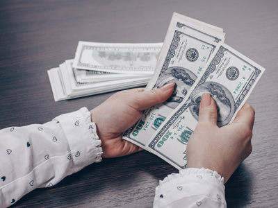 pair of hands counting cash
