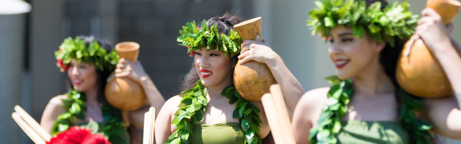 Members of the Polynesian Club of Fresno perform tradition island dances during the luau celebration at Clovis Community College on April 24