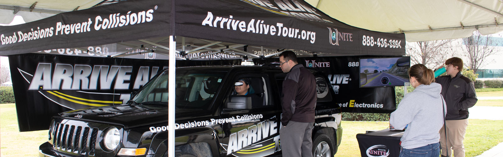 Arrive Alive tour bus on campus at CCC