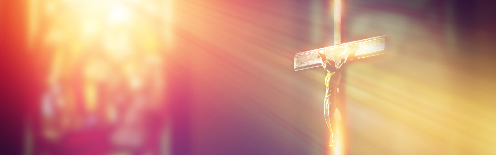 light shining on crucifix