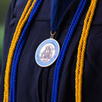 graduation regalia and medal
